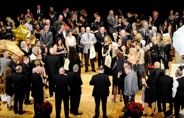 Don Knight | The Herald Bulletin<br /> Festival of Trees Gala attendees mingle on stage at the Paramount on Saturday. The event kicks off the annual Festival of Trees for the Paramount.