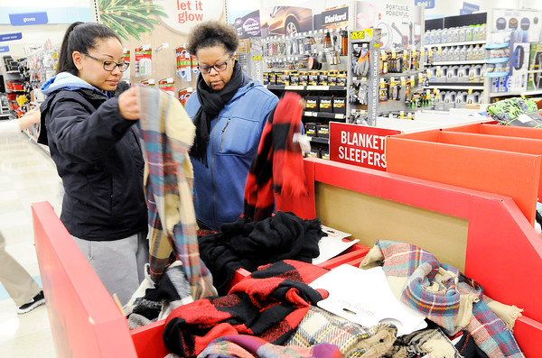 Don Knight   The Herald Bulletin<br /> From left, Morgan and Natasha Edwards shop at the Meijer in Anderson early Friday morning. With many sales starting on Thursday and more shoppers turning to online shopping crowds were light Friday morning.