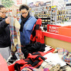 Don Knight | The Herald Bulletin<br /> From left, Morgan and Natasha Edwards shop at the Meijer in Anderson early Friday morning. With many sales starting on Thursday and more shoppers turning to online shopping crowds were light Friday morning.