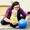 Don Knight | The Herald Bulletin<br /> Rachel Hochstetler and her son Leland, seven months, roll a ball as during a Music Makers class for infants and toddlers at Edgewood Elementary on Friday.