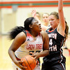 Don Knight | The Herald Bulletin<br /> Anderson's Kenigia Hamilton drives into the low post against Huntington North's Rileigh Johnson on Saturday.