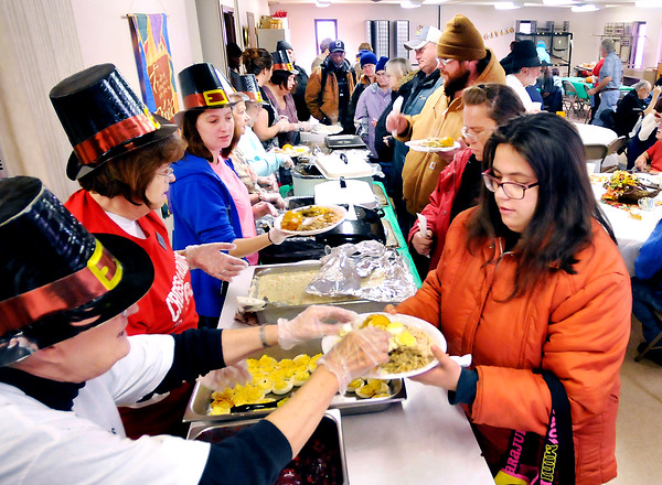 John P. Cleary    The Herald Bulletin<br /> Cross Roads United Methodist Church held their Lawson-Wellman Memorial Thanksgiving Dinner for the community Tuesday afternoon. This was the 14th year for the holiday feast that they hold on Tuesdays so more people can attend by taking the city bus service.