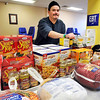John P. Cleary |  The Herald Bulletin<br /> David Keesling looks over some of the food that has been donated for the Christian Center's annual Thanksgiving dinner. The Christian Center still is in need for food donations for this years holiday meal.
