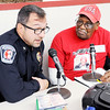 Don Knight | The Herald Bulletin<br /> James Warner has police chief Tony Watters on his radio broadcast during the  The Gospel Highlights Radio Broadcast 34th Annual Community Thanksgiving Day Dinner at the Geater Community Center on Thursday.