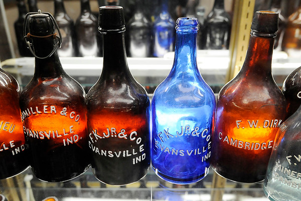 "Don Knight |  The Herald Bulletin<br /> Indiana Ale Bottles from 1855-1877 are on display as part of the ""History of Brewing, Distilling and Bottling in Indiana"" exhibit at the Madison County Historical Society."