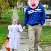 "John P. Cleary |  The Herald Bulletin<br /> Princess Miriam Wlison, 5, trick-or treats along Crystal Street with her ""crybaby"" father Avery Wilson Tuesday evening."