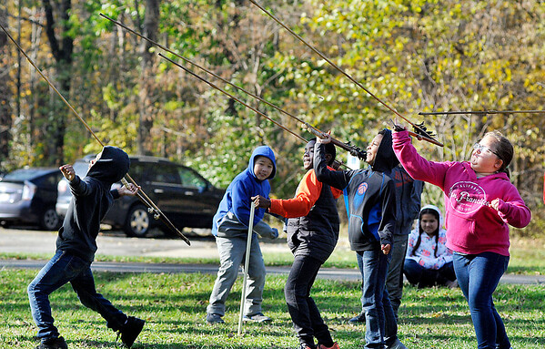 John P. Cleary |  The Herald Bulletin<br /> These Eastside Elementary Fourth graders let go with their attempts to use a spear-thrower or Atlatl to toss a dart  at a target during a field trip to Mounds State Park Friday. This was one of the many activities for the students during their day-long outing at the park.