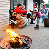 John P. Cleary |  The Herald Bulletin<br /> Lynn and Patrick Hill keep themselves warm with this small fire while greeting trick-or-treaters at their Iroquois Street home in North Anderson on a cold Halloween evening.
