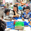 John P. Cleary |  The Herald Bulletin<br /> Killbuck School kindergarten teacher April Dock checks on her students as they work on a class project.