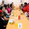 "Don Knight |  The Herald Bulletin<br /> Students get a chance to use the etiquette lessons they learned as they sit down for lunch during ""Touch of Class"" at New Hope United Methodist Church on Saturday. Students in grades 1-12 rotated through classes on four different subjects."
