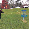 Rebecca R. Bibbs | The Herald Bulletin<br /> Kyle Clem's disc makes the elevated basket at the new Sanders Memorial Disc Golf Course at Edgewater Park in Anderson.