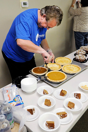 Don Knight |  The Herald Bulletin<br /> Delbert Snyder serves up slices of sugar cream pie during the Thanksgiving meal South Meridian Church of God on Thursday.