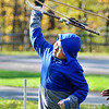 John P. Cleary |  The Herald Bulletin<br /> Eastside Elementary Fourth grader George Chen lets go with his attempt to use a spear-thrower or Atlatl to toss a dart  at a target during a field trip to Mounds State Park Friday.