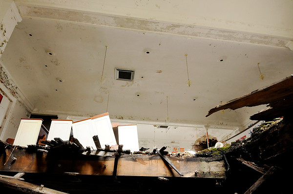 Don Knight | The Herald Bulletin<br /> Looking through an open window you can see were a section of the sanctuary floor has collapsed into the basement of the former church at 334 west 14th Street.