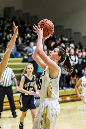 Chris Martin | for The Herald Bulletin.<br /> Madison-Grant's Kaylo Comer puts a rebound back up Friday night at home against Oak Hill.