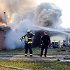 John P. Cleary |  The Herald Bulletin<br /> Firefighters from multiple departments battle a house fire on Indiana 9 and County Road 375N Wednesday morning.
