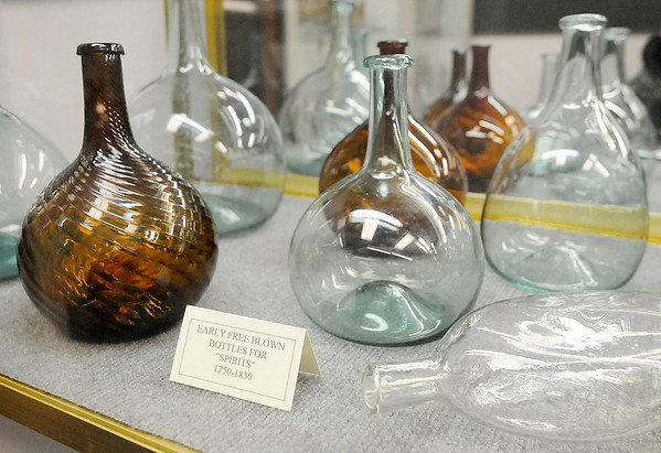 "Don Knight |  The Herald Bulletin<br /> Spirit bottles dating back to 1750 are part of the ""History of Brewing, Distilling and Bottling in Indiana"" exhibit at the Madison County Historical Society."