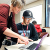 John P. Cleary |  The Herald Bulletin<br /> Instructor Jamie Westgate works with student T.J. Lambertson during class at the Giant Wildcat Academy at Indiana Wesleyan University in Marion.