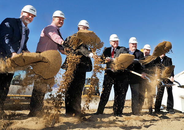John P. Cleary |  The Herald Bulletin<br /> Officials of Tippmann Group, Interstate Warehousing, and the City of Anderson toss sand during a ceremonial groundbreaking Wednesday for a new $30 million, 250,000 square-foot cold storage warehouse facility located 4447 S. 400 West, Anderson.
