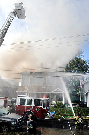 John P. Cleary |  The Herald Bulletin<br /> Anderson firefighters battle a house fire at 2219 Central Avenue Thursday afternoon.