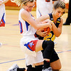 Don Knight | The Herald Bulletin<br /> Elwood's Claudia Leavell and Shenandoah's Sami DeLey scramble for control of the ball as the Panthers hosted the Raiders on Thursday.