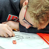 John P. Cleary |  The Herald Bulletin<br /> Anderson High School freshman Jaric Bagianski works on his self-portrait project in his Introduction to 2D Drawing class this past week.