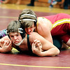 John P. Cleary |  The Herald Bulletin<br /> Alexandria's Jake Clark, top, works on Anderson's Conner Poe in their 170 lb. weight class match Monday. Clark pinned Poe to win the match.