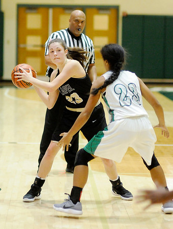 Don Knight | The Herald Bulletin<br /> Lapel's Zoe Freer looks to pass as she is guarded by Westfield's Ava Henson on Wednesday.