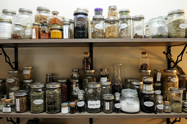 Don Knight |  The Herald Bulletin<br /> Apothecary at Twisted Twigs used to make different mixes for their products.
