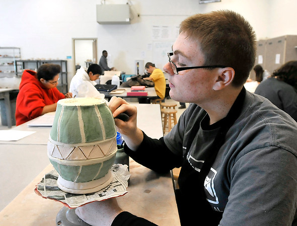 John P. Cleary |  The Herald Bulletin<br /> Senior Ethan Tullis works on his project in his ceramics class at Anderson High School this past week.