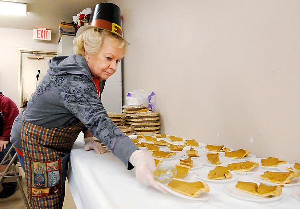 Don Knight |  The Herald Bulletin<br /> Alice Baker sets out servings of pumpkin pie during the John Lawson / Fran Wellman Memorial Thanksgiving Dinner at Cross Roads United Methodist Church in Anderson on Tuesday. Wicks donated the pies, Family Video donated 40 turkeys, the city provide bus rides and over 100 volunteers cooking, preparing and cleaning made the dinner possible.