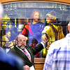 John P. Cleary |  The Herald Bulletin<br /> Art Jaggard, pastor at First Baptist Church, conducts the dedication of the refurbished stained-glass picture of Christ at the Anderson YMCA Wednesday.