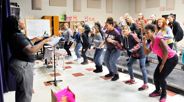 John P. Cleary |  The Herald Bulletin Highland Middle School choir director Shequez Burgess directs her choir students as they run through a song during class Monday.
