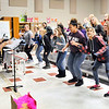 John P. Cleary |  The Herald Bulletin<br /> Highland Middle School choir director Shequez Burgess directs her choir students as they run through a song during class Monday.