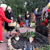 Don Knight |  The Herald Bulletin<br /> Representatives from AMVETS Post 25 Auxiliary and former Auxiliary National Presidents Virginia Hays, left, and Doris Shrake place flowers in a vase as the 21 names of fallen heroes from Adams Township are read during the rededication of Markleville Memorial Square at the corner of Indiana 38 and County Road 300 East on Saturday.