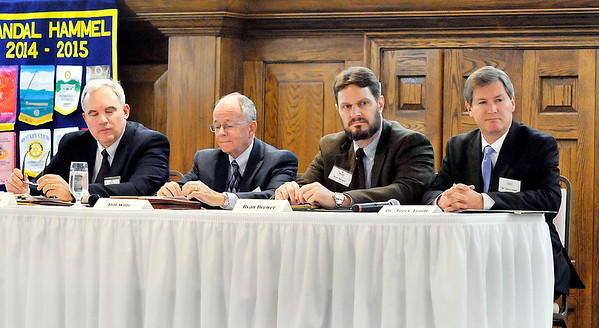 John P. Cleary |  The Herald Bulletin<br /> Doug McCoy, Bill Witte, and Ryan Brewer, all from the IU Kelley School of Business, and Terry Truitt, dean of Anderson University Falls School of Business, made up the panel for the annual business outlook for Indiana and Madison County Tuesday at the Anderson Rotary Club.