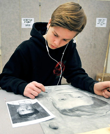 John P. Cleary |  The Herald Bulletin<br /> Ryan Barcus, Anderson High School freshman, works on his self-portrait project in his Introduction to 2D Drawing class this past week.