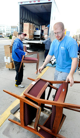 John P. Cleary |  The Herald Bulletin<br /> Crown Wheaton employees load up furniture from the Commissioners offices Monday afternoon as they started moving the Madison County Government Center first floor offices out of the courthouse to their new, temporary offices in the Anderson Tower building.