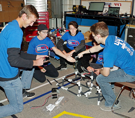 Mark Maynard   for The Herald Bulletin<br /> Members of Explorer Post 447, also known as Team Roboto 447, work together building the mock-up of an all-terrain mechanized wheelchair for a small child who cannot walk.