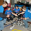 Mark Maynard | for The Herald Bulletin<br /> Members of Explorer Post 447, also known as Team Roboto 447, work together building the mock-up of an all-terrain mechanized wheelchair for a small child who cannot walk.