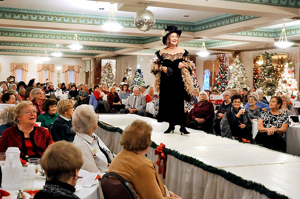 "John P. Cleary |  The Herald Bulletin<br /> Sharon McNabney shows off her ""little black dress"" during the Gruenewald Historic House ""Little Black Dress"" style show & luncheon at the Paramount Ballroom Tuesday as part of the Festival of Trees."