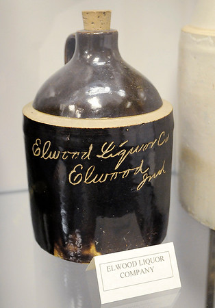 "Don Knight |  The Herald Bulletin<br /> A jug from the Elwood Liquor Company is part of the ""History of Brewing, Distilling and Bottling in Indiana"" exhibit at the Madison County Historical Society."