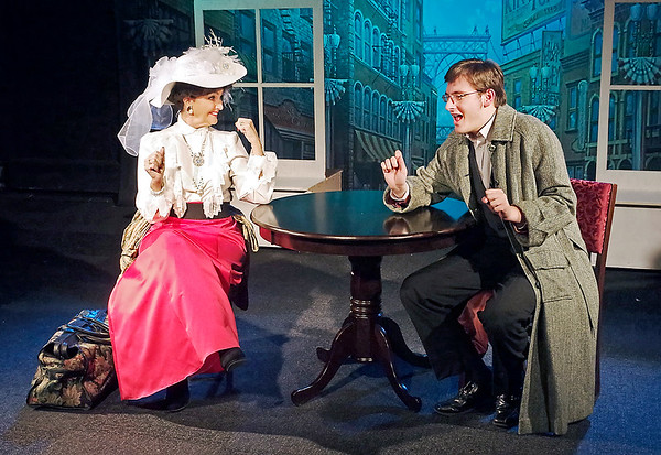 Mark Maynard | for The Herald Bulletin<br /> Matchmaker Dolly Gallagher Levi (Jill O'Malia) is excited to hear artist Ambrose Kemper's (Tyler Marx) plans to wed his love, Ermengarde, in spite of her Uncle Horace's objections.