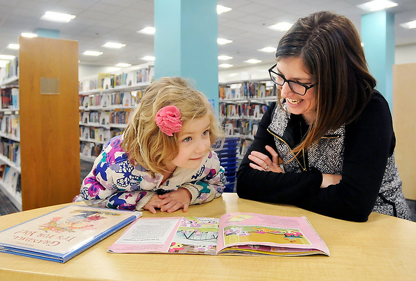 John P. Cleary |  The Herald Bulletin<br /> June Woodell, 4, thinks about the question her mother, Annie Woodell, asked her as they read together in the newly remodeled Children's Department at Anderson Public Library this past week.