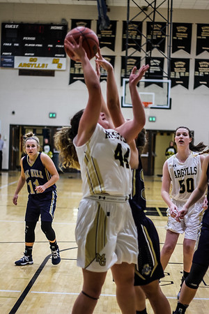 Chris Martin for The Herald Bulletin.<br /> Madison-Grant's McKenna Lugar drives in for a layup Friday night at home against Oak Hill