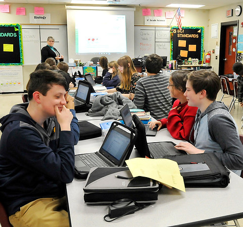 John P. Cleary |  The Herald Bulletin Highland Middle School students in Laura Raper's Eighth-grade Biology class watch the overhead for questions during Monday's class time.