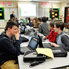 John P. Cleary |  The Herald Bulletin<br /> Highland Middle School students in Laura Raper's Eighth-grade Biology class watch the overhead for questions during Monday's class time.