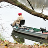 John P. Cleary |  The Herald Bulletin<br /> Framed by this tree this angler works the shoreline around Shadyside Lake on a cold, damp Monday afternoon.
