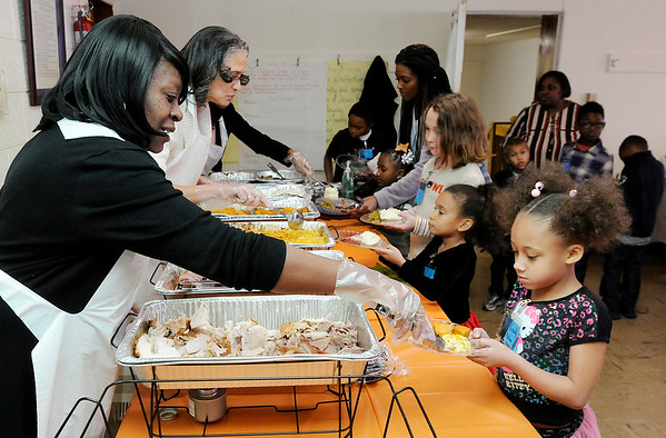 "Don Knight |  The Herald Bulletin<br /> Angela Falker puts a serving of turkey on Kassidy Malone's plate as students at lunch during ""Touch of Class"" at New Hope United Methodist Church on Saturday."