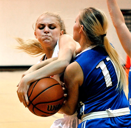 John P. Cleary |  The Herald Bulletin<br /> Liberty Christian's Savannah Rees and Southern Wells Jessica Yencer fight the the loose ball.